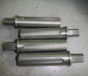 Connecting shaft in vertical form fill seal machine